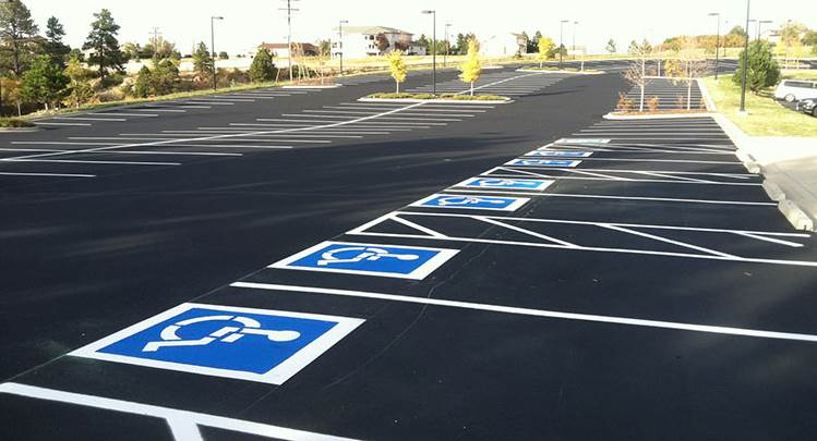 Freshly paved asphalt and parking lot striping with handicap spots in Colorado Springss