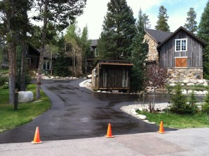 Sealcoating drying on a residential driveway
