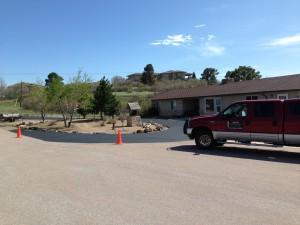 Circular driveway at residence with new asphalt
