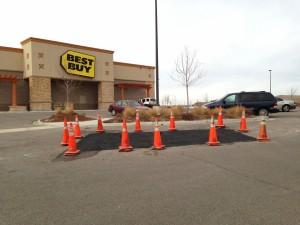 Parking lot asphalt repair in front of Best Buy