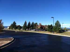 Asphalt sealcoating drying on commercial driveway
